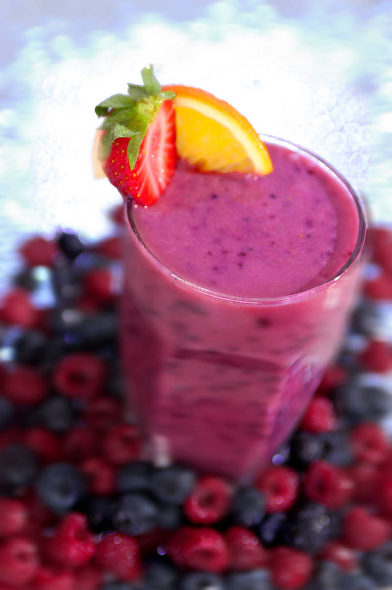 Vibrant berry smoothie, raspberry and blueberry. Stock Photography Free for Commercial Use.