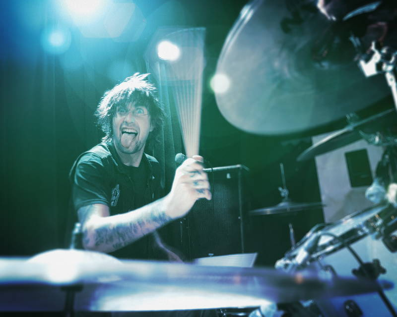 Rock band drummer onstage at music festival. Stock Photography Free for Commercial Use.