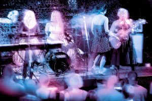 All girls rock band onstage at music festival. Stock Photography Free for Commercial Use.