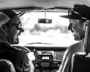 Van road trip in vintage van with two friends smiling in black and white. Stock Photography Free for Commercial Use.
