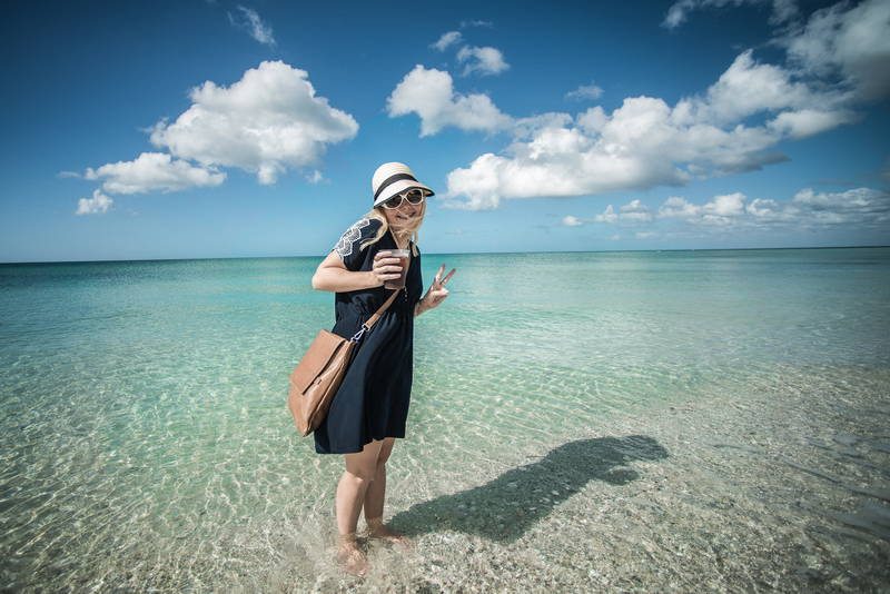 Beautiful woman on beach in blue water. Stock Photography Free for Commercial Use.