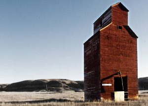 Grain elevator in the frost below the foothills. Stock Photography Free for Commercial Use.