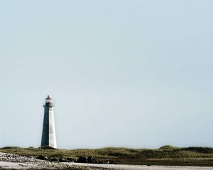 Lighthouse on a cliff on a clear day. Stock Photography Free for Commercial Use.