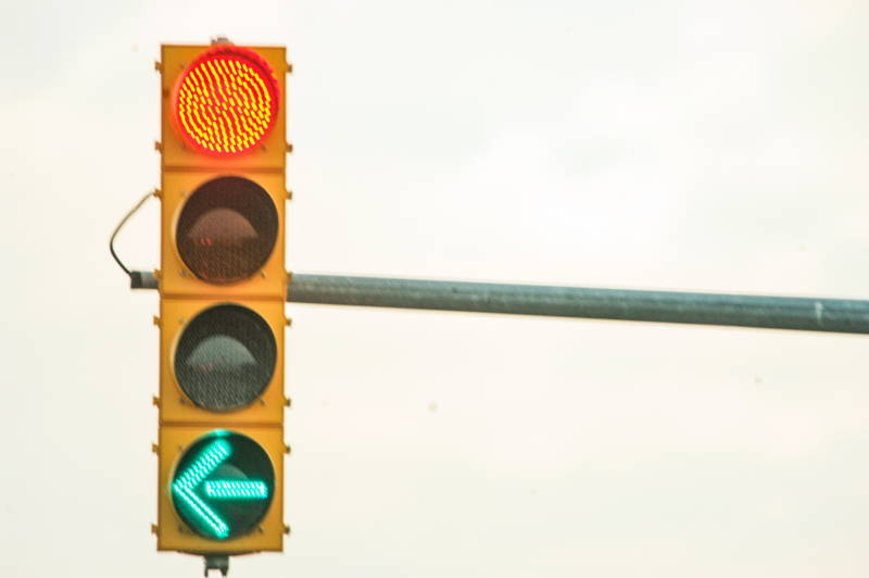 Traffic light on advanced left hand turn. Stock Photography Free for Commercial Use.